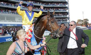 Mike de Kock and wife Dianne lead in Bold Silvano and Anthony Delpech after their victory in the R3 million Vodacom Durban July at Greyville racecourse in Durban yesterday
