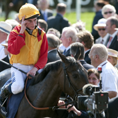 Ryan Moore and Snow Fairy after winning the Oaks Epsom 04.06.2010