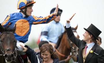 High fives between Fozzy Stack and Johnny Murtagh after High Award's win in the Woodcote Stakes Epsom 05.06.2010