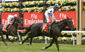 Gerald Mosse riding Americain crosses the line to win race Seven Emirates Melbourne Cup during Melbourne Cup Day at Flemington