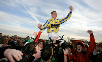 Paul Hanagan is lifted into the air by his colleagues after winning the flat jockeys championship Doncaster 06.11.2010