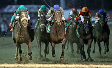 Blame (5center) with jockey Garrett Gomez aboard edges out Zenyatta (#8 left) to win the Classic during the Breeders' Cup