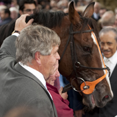 Sir Michael Stoute with Workforce after winning the Arc Longchamp 03.10.2010