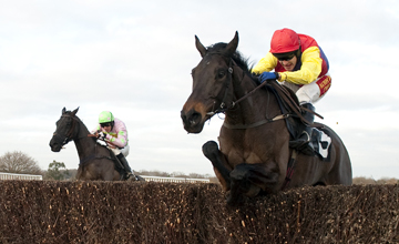Minella Boys (left) jumps the 2nd last fence behind Master Overseer to win the Sussex National Plumpton 02.01.2011