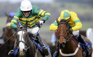 Tony McCoy riding Synchronised (L) clears the last to win The Coral Welsh National at Chepstow 08.01.2011
