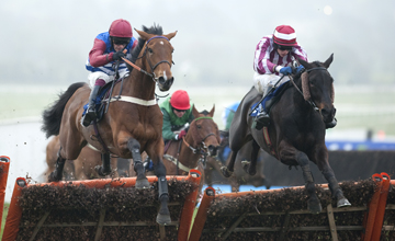 What A Charm (Paul Townend,right) jumps the last and beats Kumbeshwar in the juvenile hurdle Cheltenham Festival 16.03.2011