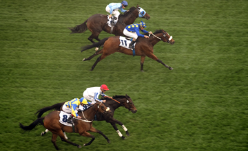 J J The Jet Plane (2nd from top) wins the Al Quoz Sprint from War Artist (red cap) Meydan 26.03.2011