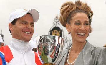 Jockey Danny Nikolic poses with the Crown Oaks trophy after receibing it from Sarah Jessica Parker