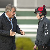 Sir Michael Stoute gives instructions to Ryan Moore at Sandown