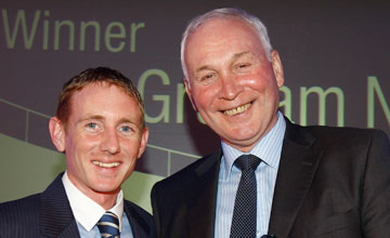 Paul Hanagan presents Graham Nicklin with The Stud Staff award at The Godolphin Stud and Stable Staff Awards