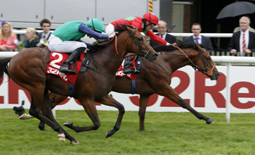 Olympic Glory (far side) wins the Group 2 Superlative Stakes at Newmarket