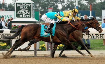 ELMONT, NY - JUNE 09: Union Rags ridden by John Velazquez narrowly beats Paynter ridden by Mike Smith during the 144th running of the Belmont Stakes at Belmont Park on June 9, 2012 in Elmont, New York.