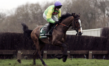 Ruby Walsh and Kauto Star pull away from the first fence before landing The King George VI Steeple Chase Race at Kempton racecourse on December 26, 2006