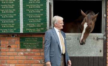 Clive Smith stands outside Kauto Star's box at Paul Nicholls Manor Farm Stables