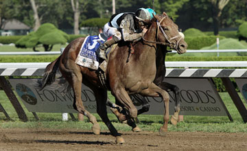 Capo Bastone (Street Boss) and jockey Irad Ortiz Jr. win the Kings Bishop (Gr I) at Saratoga Racecourse 8/24/13.