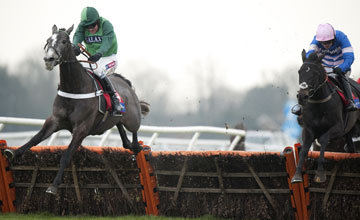 Ruby Walsh in action on Irish Saint who beat Vasco du Ronceray (Barry Geraghty) in the Adonis juvenile hurdle