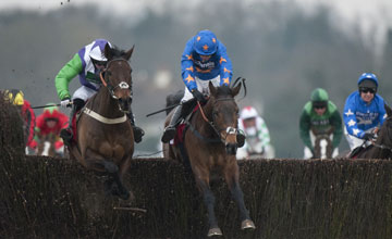 The winner Opening Batsman (Noel Fehily,left) jumps the last fence with Rolling Aces in the 3m handicap chase