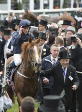 Ruler Of The World (Ryan Moore) wins the Derby