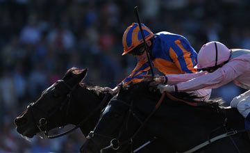 Jockey Ryan Moore (L) atop Magician edges William Buick atop The Fugue to win the Turf during the 2013 Breeders' Cup World Championships at Santa Anita Park on November 2, 2013