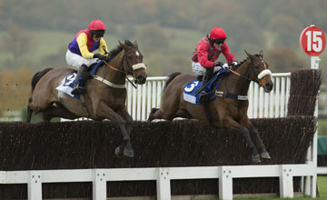 Handy Andy (left) jumps the 2nd last fence with Charingworth as he wins the 3m amateur riders chase