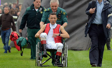 FRANKIE DETTORI in a wheelchair