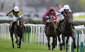 Leighton Aspell riding Pineau De Re (R) win The Crabbie's Grand National Steeple Chase at Aintree