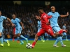 MANCHESTER ENGLAND AUGUST 25 Daniel Sturridge of Liverpool shoots at goal during the Barclays Premier League match between Manchester City and Liverpool at the Etihad Stadium on August 25 2014 in Manchester England Photo by Clive BrunskillGetty