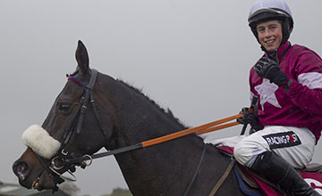 Bryan Cooper celebrates winning the JNwine.com Champion Chase on Roi Du Mee Down Royal Pic: Patrick McCann 02.11.2013