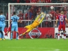 MUNICH GERMANY SEPTEMBER 17 Joe Hart of Manchester City fails to stop the shot by Jerome Boateng of Bayern Muenchen not in picture for the opening goal during the UEFA Champions League Group E match between Bayern Munchen and Manchester City at the