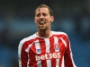 MANCHESTER ENGLAND AUGUST 30 Peter Crouch of Stoke City during the end of the Barclays Premier League between Manchester City and Stoke City at Etihad Stadium on August 30 2014 in Manchester England Photo by Shaun BotterillGetty Images