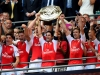 Arsenal captain Mikel Arteta lifts the Community Shield with his team