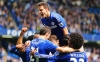Cesar Azpilicueta of Chelsea top and team mates mob Eden Hazard obscured