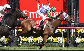 MELBOURNE, AUSTRALIA - NOVEMBER 03: Michelle Payne riding Prince of Penzance defeats Frankie Dettori riding Max Dynamite in race 7, the Emirates Melbourne Cup on Melbourne Cup Day at Flemington Racecourse on November 3, 2015 in Melbourne, Australia.
