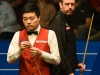 SHEFFIELD ENGLAND APRIL 26 Ding Junhui of China lines up a shot in front of Mark Williams of Wales during their quarter final match on day eleven of the World Championship Snooker at Crucible Theatre on April 26 2016 in Sheffield England Photo b