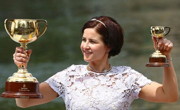 Australian star Michelle Payne with the Melbourne Cup