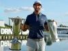 CARMEL IN SEPTEMBER 11 Dustin Johnson poses with the championship trophies after a three stroke victory at the BMW Championship at Crooked Stick Golf Club on September 11 2016 in Carmel Indiana Photo by Scott HalleranGetty Images