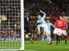 MANCHESTER ENGLAND DECEMBER 10 David Silva of Manchester City scores the first Manchester City goal past David De Gea of Manchester United during the Premier League match between Manchester United and Manchester City at Old Trafford on December 10 2