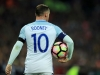 LONDON ENGLAND NOVEMBER 11 Wayne Rooney of England carries the match ball during the FIFA 2018 World Cup qualifying match between England and Scotland at Wembley Stadium on November 11 2016 in London England Photo by Richard HeathcoteGetty Imag
