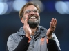 MANCHESTER ENGLAND APRIL 10 Jurgen Klopp of Liverpool applauds the fans after victory in the Quarter Final Second Leg match between Manchester City and Liverpool at Etihad Stadium on April 10 2018 in Manchester England Photo by Laurence Griffith