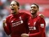 LONDON ENGLAND SEPTEMBER 15 Virgil van Dijk of Liverpool and team mate Joe Gomez celebrate following the Premier League match between Tottenham Hotspur and Liverpool FC at Wembley Stadium on September 15 2018 in London United Kingdom Photo by Ju