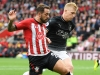 Southampton's Danny Ings of Southampton is challenged by Ben Mee of Burnley
